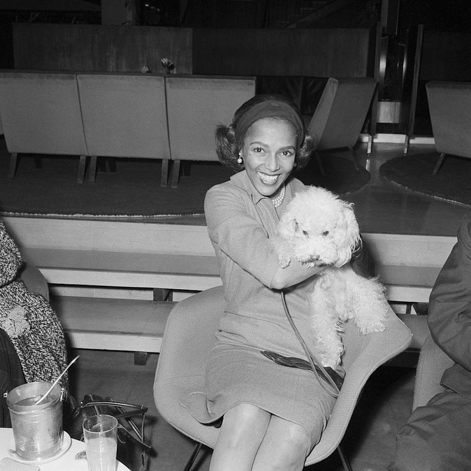 <p>Actress Dorothy Dandridge gives her dog a great hug at Orly Airport in Paris. It's unknown if this was her beloved pup, Cissi. </p>