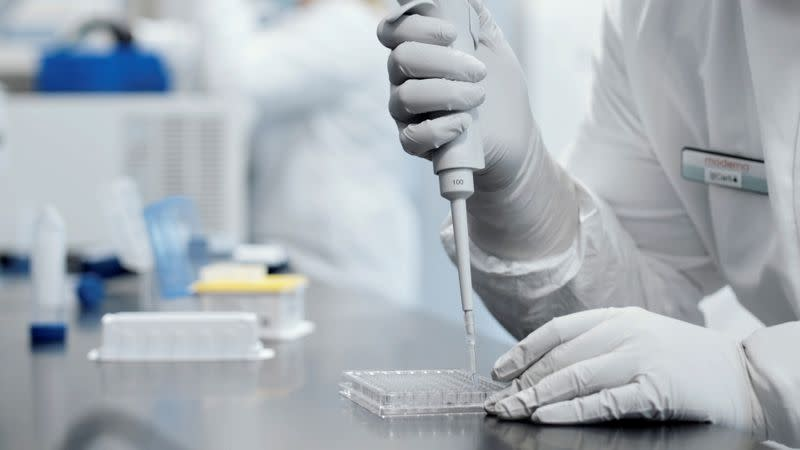 FILE PHOTO: A researcher works in a lab run by Moderna