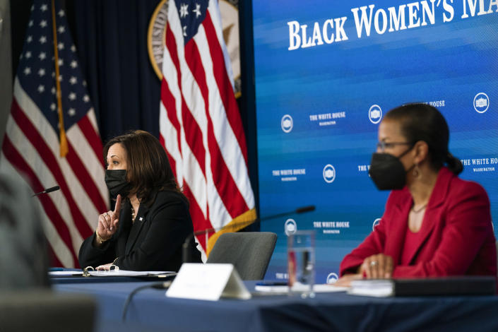 Vice President Kamala Harris, left, and White House Domestic Policy director Susan Rice, participate in a roundtable discussion highlighting the disparities that Black women face in maternal health at the Eisenhower Executive Office Building on the White House complex in Washington, Tuesday, April 13, 2021. (AP Photo/Manuel Balce Ceneta)