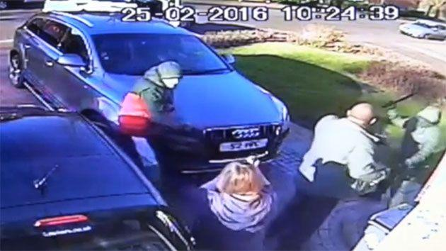 The robbers emerge from the white car and attack the 57-year-old man, demanding his keys. Photo: UK Police