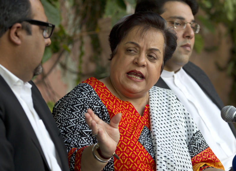 Shireen Mazari, center, information secretary of the Pakistan Tehreek-e-Insaf party, addresses a news conference with party officials in Islamabad, Pakistan, Wednesday, Nov. 27, 2013. A political party opposed to U.S. drone attacks in Pakistan revealed what it said was the name of the top CIA spy in the country on Wednesday and called for him and the head of the agency to be tried for a recent missile strike. Pakistani police and intelligence officials have said the attack on an Islamic seminary in Khyber Pakhtunkhwa's Hangu district on Nov. 21 killed five people. (AP Photo/B.K. Bangash)