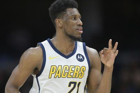 Jan 8, 2019; Cleveland, OH, USA; Indiana Pacers forward Thaddeus Young (21) celebrates after making a three-point basket in the third quarter against the Cleveland Cavaliers at Quicken Loans Arena. Mandatory Credit: David Richard-USA TODAY Sports