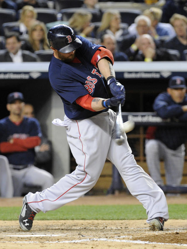 Boston Red Sox batter Jonny Gomes hits a home run during the sixth inning of a baseball game against the New York Yankees Friday, April 11, 2014, at Yankee Stadium in New York. (AP Photo/Bill Kostroun)