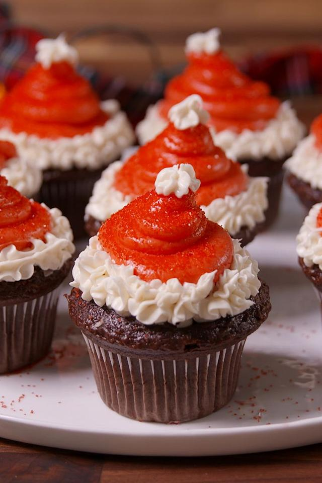 """<p>These Santa cupcakes are almost too cute to eat. <em>Almost.</em></p><p>Get the recipe from <a href=""""/cooking/recipe-ideas/recipes/a50541/santa-hat-cupcakes-recipe/"""" target=""""_blank"""">Delish</a>.</p><p><strong><a class=""""body-btn-link"""" href=""""https://www.amazon.com/Wilton-Recipe-Nonstick-12-Cup-Regular/dp/B003W0UMPI/?tag=syn-yahoo-20&ascsubtag=%5Bartid%7C1782.g.1294%5Bsrc%7Cyahoo-us"""" target=""""_blank"""">BUY NOW</a><em> Nonstick Muffin Pan, $7, </em><em><span class=""""redactor-unlink"""">amazon.com</span></em></strong><br></p>"""