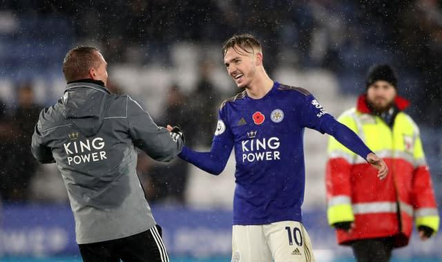Leicester City's James Maddison (right) and manager Brendan Rodgers celebrate (Nick Potts/PA)