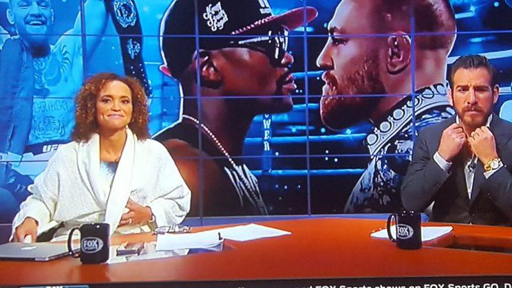 Fox broadcaster Karyn Bryant shown wearing a robe on live TV due to a FOX Sports producing glitch during the Floyd Mayweather-Conor McGregor press conference(Twitter)