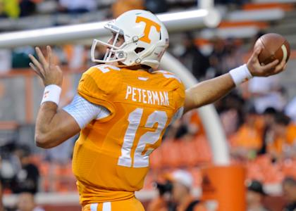 Oct 25, 2014; Knoxville, TN, USA; Tennessee Volunteers quarterback Nathan Peterman (12) warms up before the game against the Alabama Crimson Tide at Neyland Stadium. (Randy Sartin-USA TODAY Sports)