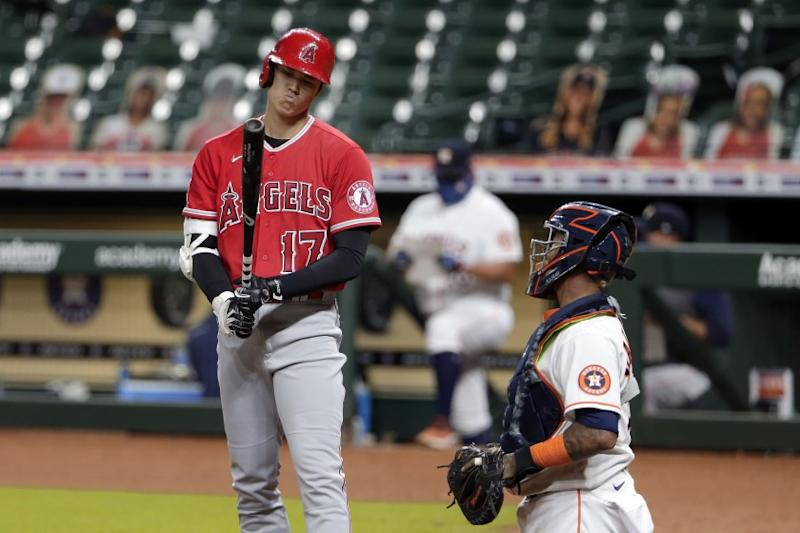 Los Angeles Angels designated hitter Shohei Ohtani (17) reacts to a strike call during a baseball game against the Houston Astros Monday, Aug. 24, 2020, in Houston. (AP Photo/Michael Wyke)