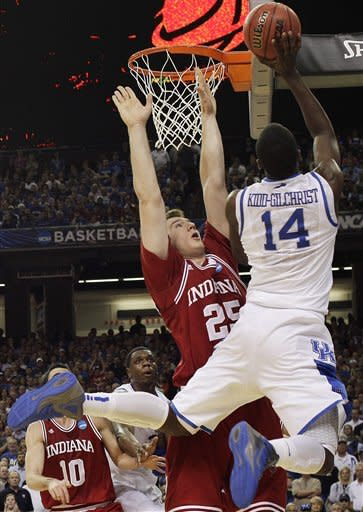 Kentucky's Michael Kidd-Gilchrist (14)tries to shoot over Indiana's Tom Pritchard during the first half of an NCAA tournament South Regional semifinal college basketball game Friday, March 23, 2012, in Atlanta. (AP Photo/David J. Phillip)