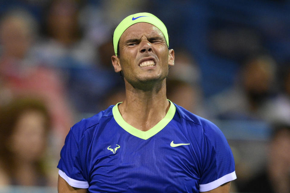 FILE - In this Thursday, Aug. 5, 2021 file photo, Rafael Nadal, of Spain, reacts during a match against Lloyd Harris, of South Africa, at the Citi Open tennis tournament, in Washington. Rafael Nadal has pulled out of the U.S. Open and says he will not play tennis again this year because of a nagging foot injury, it was announced Friday, Aug, 20. The Spaniard sat out both Wimbledon and the Olympics because of fatigue after losing to Novak Djokovic in the French Open semifinals. (AP Photo/Nick Wass, file)