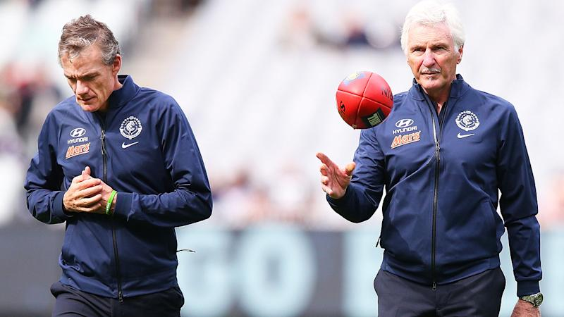 Dean Laidley and Mick Malthouse, pictured here at a Carlton game in 2015.