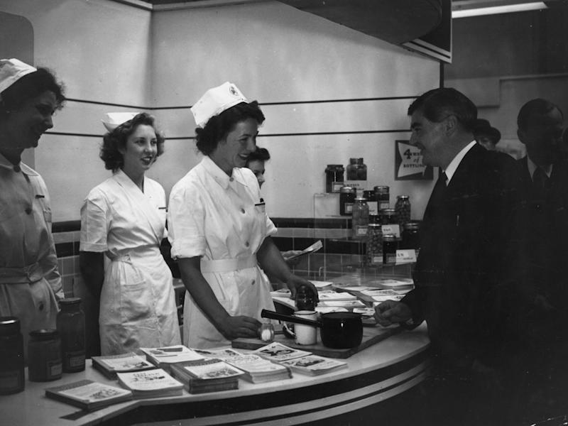 Minister of Health Aneurin Bevan jokes with nurses in 1947: Getty
