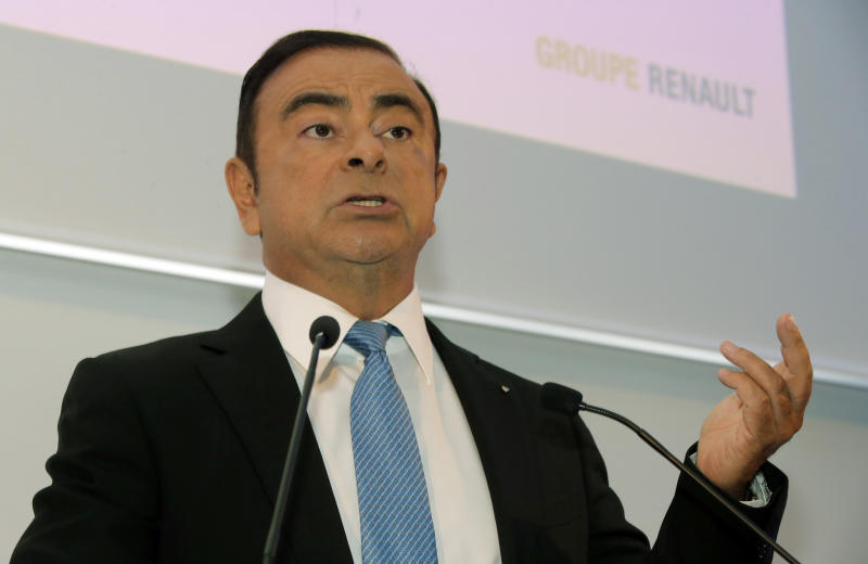 "Renault Group CEO Carlos Ghosn gestures as he speaks during a media conference at La Defense business district, outside Paris, France, Friday, Oct. 6, 2017. French carmaker Renault says half of its models will be electric or hybrid by 2022 and it's investing heavily in ""robo-vehicles"" with increasing degrees of autonomy. (AP Photo/Michel Euler)"