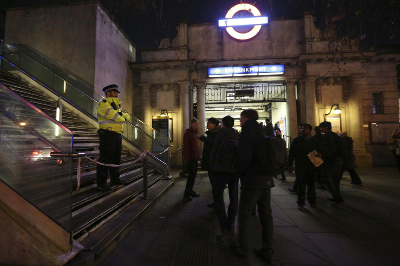 A police officer outside Embankment tube station in central London stops pedestrians from using the Hungerford Bridge, as a suspected unexploded World War II bomb has been found in the River Thames, forcing the closure of Waterloo and Westminster bridges Thursday Jan. 19, 2017. The device was found in the river by Victoria Embankment. (Jonathan Brady/PA via AP)