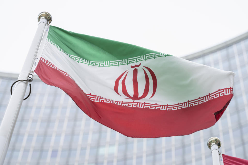 FILE - In this Monday, May 24, 2021 file photo, the flag of Iran waves in front of the the International Center building with the headquarters of the International Atomic Energy Agency, IAEA, in Vienna, Austria, Monday, May 24, 2021. The United Nations' International Atomic Energy Agency watchdog reported Monday May 31, 2021, it hasn't been able to access data important to monitoring Iran's nuclear program since late February when the Islamic Republic started restricting international inspections of its facilities. (AP Photo/Florian Schroetter, FILE)