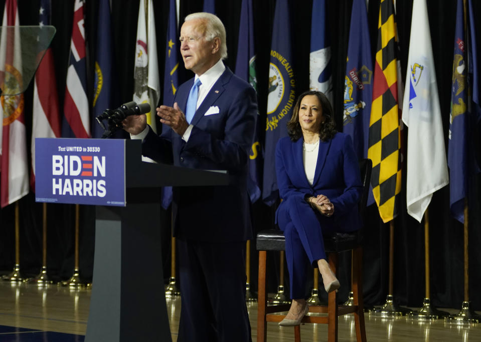 Democratic presidential candidate former Vice President Joe Biden, joined by his running mate Sen. Kamala Harris, D-Calif., speaks during a campaign event at Alexis Dupont High School in Wilmington, Del., Wednesday, Aug. 12, 2020. (AP Photo/Carolyn Kaster)