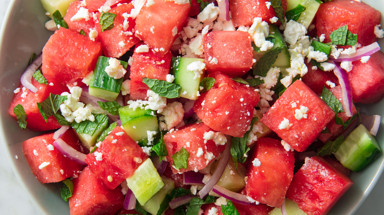 """<p>Watermelon + cucumbers is one of the most refreshing combos of all time. Throw in some mint, red onion, and feta and toss it all with a very simple vinaigrette (just olive oil + red wine vinegar), and you've got yourself a mean summer salad. </p><p>Get the <a href=""""https://www.delish.com/uk/cooking/recipes/a32998257/watermelon-salad-feta-mint-recipe/"""" rel=""""nofollow noopener"""" target=""""_blank"""" data-ylk=""""slk:Watermelon Feta Salad"""" class=""""link rapid-noclick-resp"""">Watermelon Feta Salad</a> recipe.</p>"""