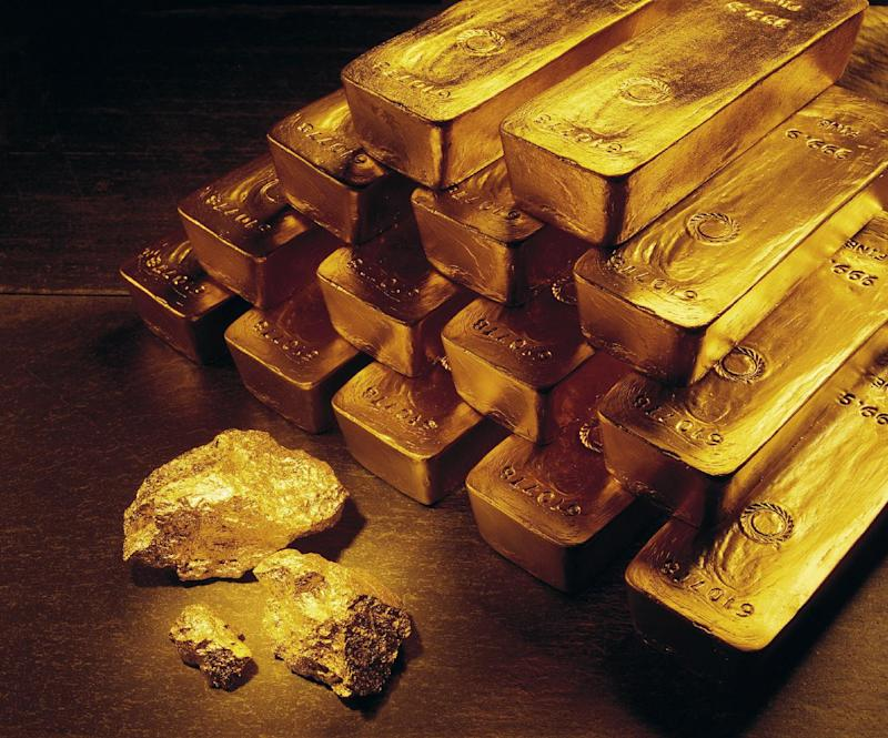 FILE - In this undated handout file photo from Newmont Mining Corporation, gold nuggets and bars are shown.  In December 2007, gold for about $840 an ounce. A little over a year later, it rose above $1,000 for the first time. It climbed gradually for the next two years. Then in March 2011, it began rocketing up. On Tuesday, Aug. 16, 2011, it traded at $1,788 an ounce, up 26 percent this year. (AP Photo/Newmont Mining, File )
