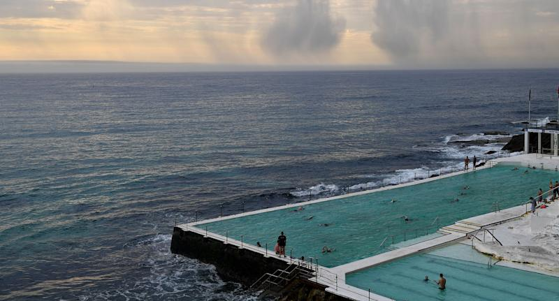 A storm is seen rolling in from Bondi Icebergs as wet weather is predicted for the city.
