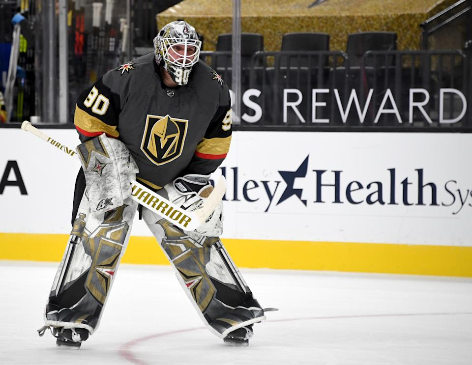 LAS VEGAS, NEVADA - JANUARY 14:  Robin Lehner #90 of the Vegas Golden Knights takes a break during a stop in play in the first period of a game against the Anaheim Ducks at T-Mobile Arena on January 14, 2021 in Las Vegas, Nevada. The Golden Knights defeated the Ducks 5-2.  (Photo by Ethan Miller/Getty Images)
