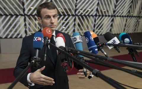 French President Emmanuel Macron talks to media prior a special session of the European Council in Brussels on Sunday - Credit: Thierry Monasse/Getty Images Europe