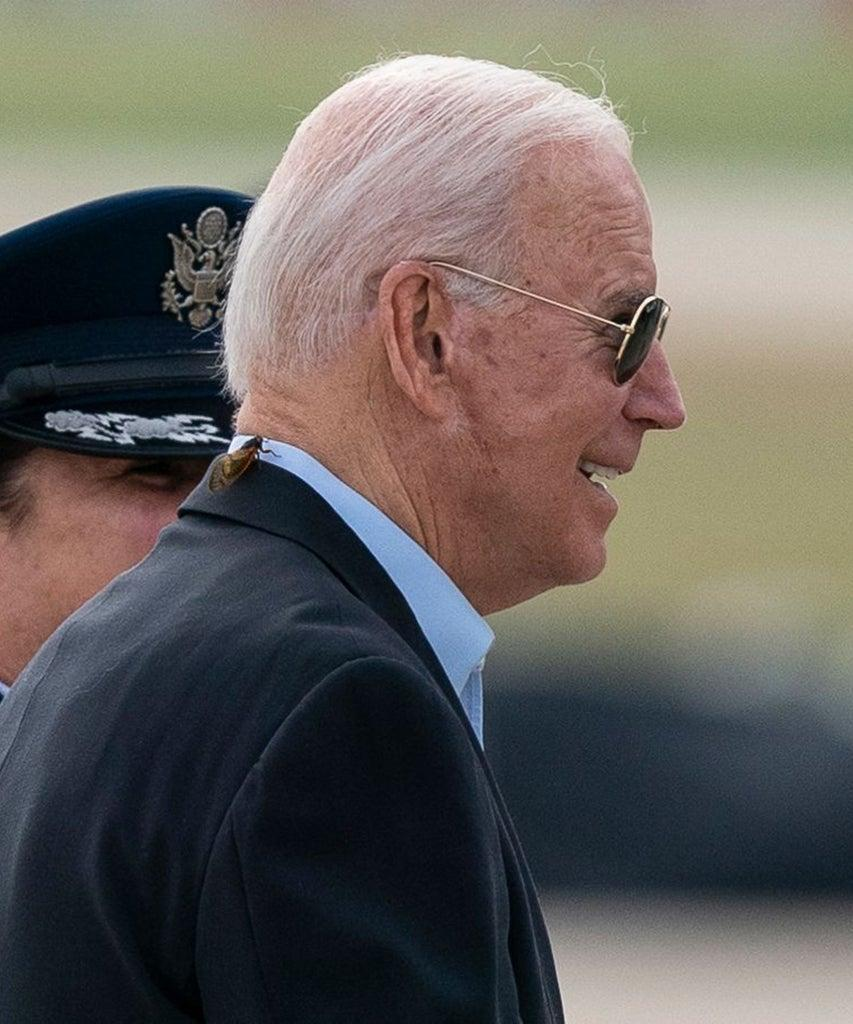 Mandatory Credit: Photo by Alex Brandon/AP/Shutterstock (12047582c) President Joe Biden, with a brood X cicada on his back, walks to board Air Force One upon departure, at Andrews Air Force Base, Md. Biden is embarking on the first overseas trip of his term, and is eager to reassert the United States on the world stage, steadying European allies deeply shaken by his predecessor and pushing democracy as the only bulwark to the rising forces of authoritarianism Biden, Andrews Air Force Base, United States – 09 Jun 2021