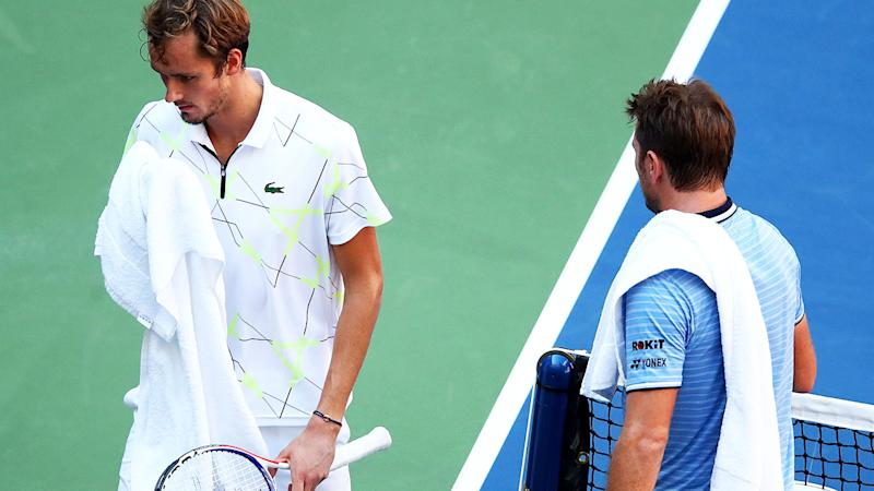 Daniil Medvedev and Stan Wawrinka, pictured here during their US Open clash.