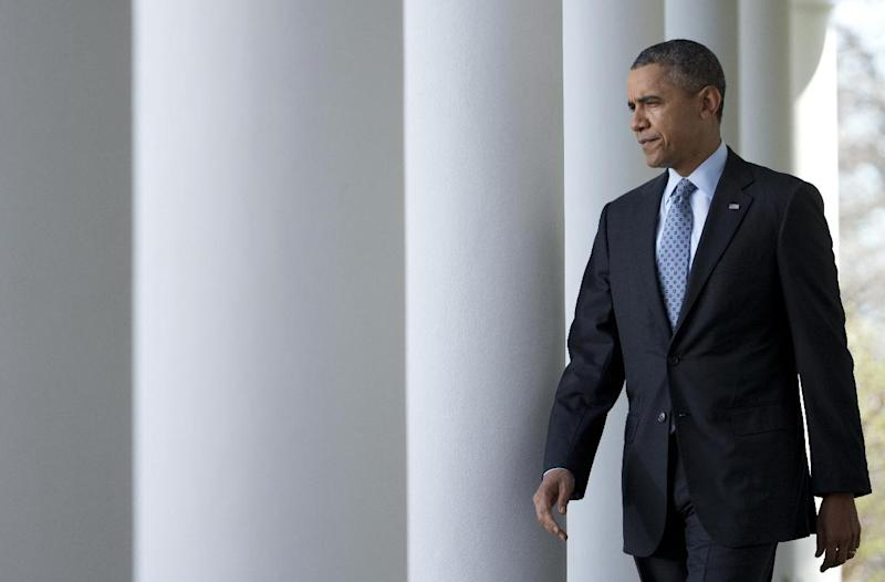 President Barack Obama walks from the Oval Office to the Rose Garden of the White House in Washington, Tuesday, April 1, 2014, to speak about the Affordable Care Act. (AP Photo/Manuel Balce Ceneta)