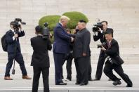 U.S. President Donald Trump meets with North Korean leader Kim Jong Un at the demilitarized zone separating the two Koreas, in Panmunjom