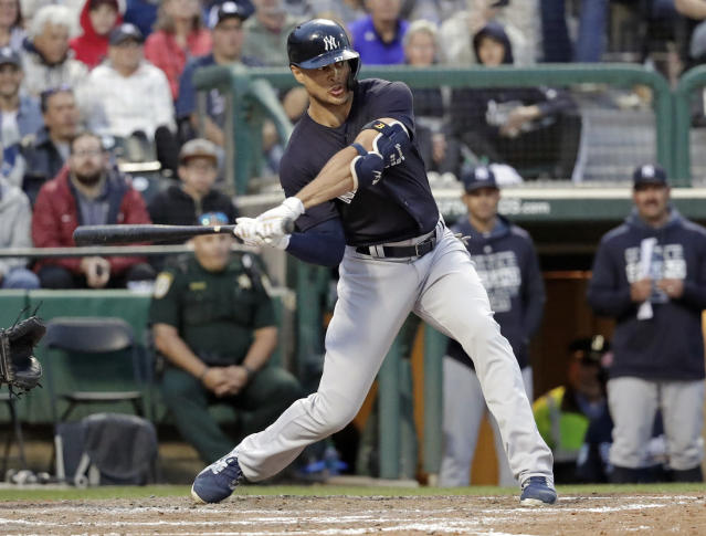 In this Monday, March 18, 2019, photo, New York Yankees' Giancarlo Stanton bats against the Atlanta Braves in a spring baseball exhibition game in Kissimmee, Fla. The New York Yankees open the season with likely baseball's most accomplished injured list. Still, the Yankees have among the most formidable batting orders in the major leagues, a power plant that includes Stanton, Aaron Judge and Gary Sanchez. (AP Photo/John Raoux)