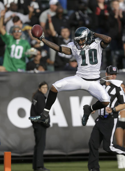 Philadelphia Eagles wide receiver DeSean Jackson (10) celebrates as he scores on a 46-yard touchdown pass from quarterback Nick Foles during the third quarter of an NFL football game against the Oakland Raiders in Oakland, Calif., Sunday, Nov. 3, 2013. (AP Photo/Marcio Jose Sanchez)