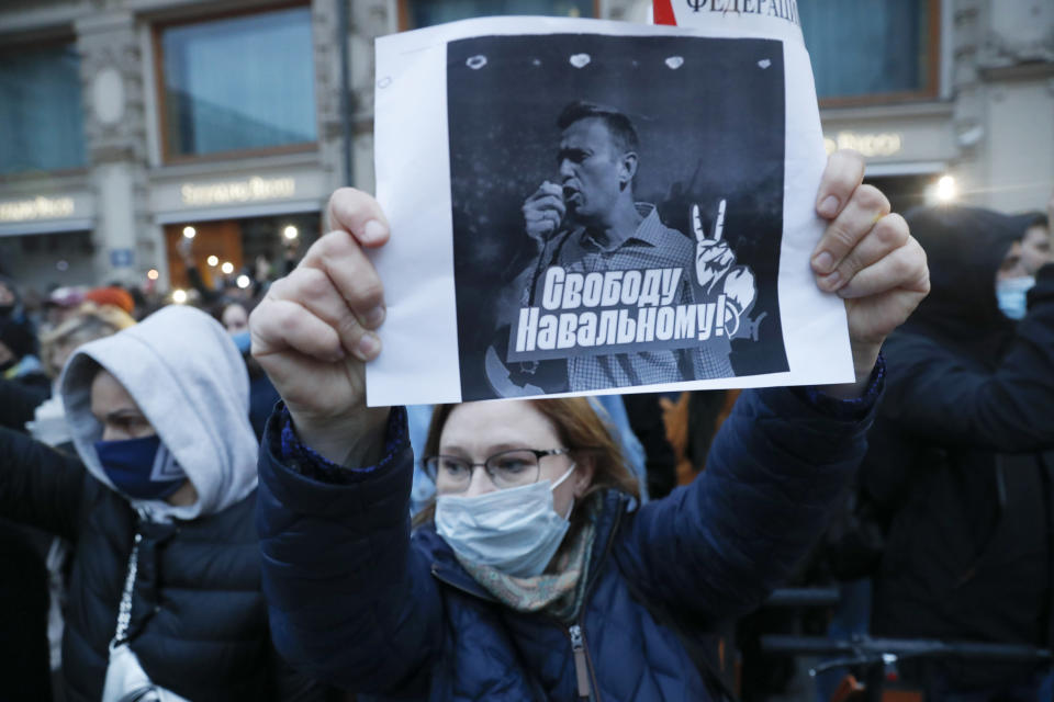 """A activist holds a poster reading """"Freedom for Navalny!"""" during the opposition rally in support of jailed opposition leader Alexei Navalny in Moscow, Russia, Wednesday, April 21, 2021. Police across Russia have arrested more than 180 people in connection with demonstrations in support of imprisoned opposition leader Alexei Navalny, according to a human rights group. (AP Photo/Pavel Golovkin)"""
