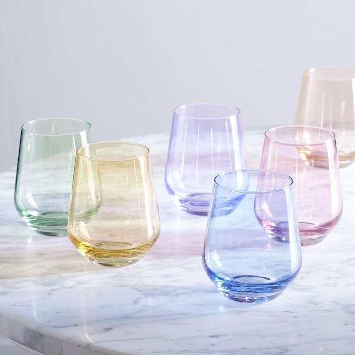 <p>The popular, handcrafted <span>Estelle Colored Glass Stemless Wine Glass Set</span> ($160) is a customer favorite. Each glass is hand-blown by glass artisans in Poland, and the set of six comes in 11 different color choices.</p>