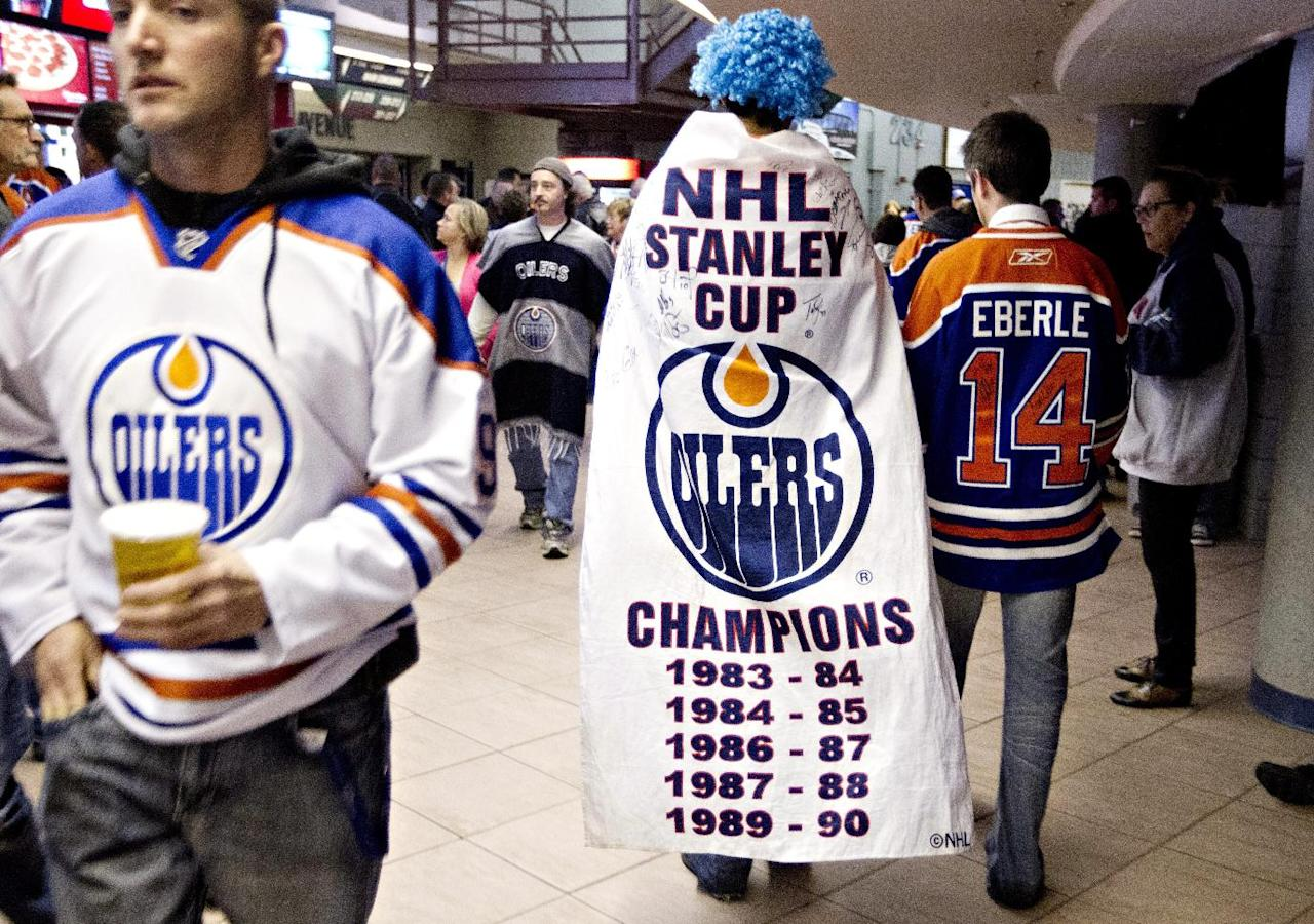 Edmonton Oilers fans make their way to their seats in Edmonton, Alberta, on Tuesday, Oct. 1, 2013, before the Oilers' NHL hockey game against the Winnipeg Jets. (AP Photo/The Canadian Press, Jason Franson)