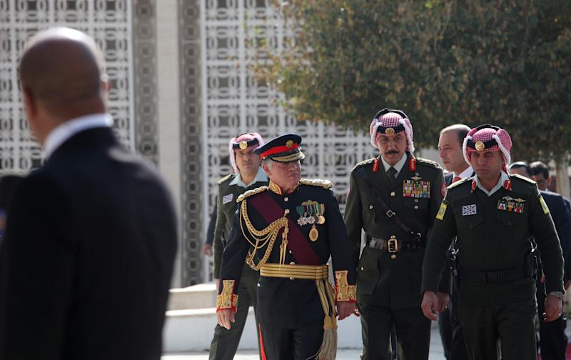 """King Abdullah II of Jordan, third from left, arrives to the parliament compound to address the opening session, in Amman, Jordan, Sunday, Nov. 3, 2013. Addressing parliament's opening session Sunday, Abdullah says his """"white revolution"""" is part of home-grown reforms he initiated weeks before the outset of the Arab Spring that saw four of his peers deposed in revolutions.(AP Photo/Mohammad Hannon)"""