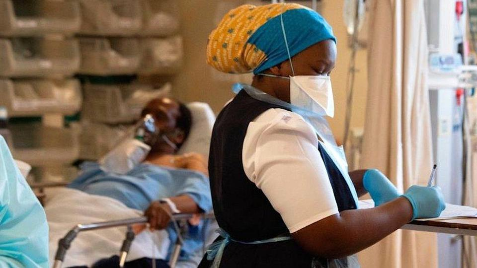 Medic writing notes at hospital near Cape Town.