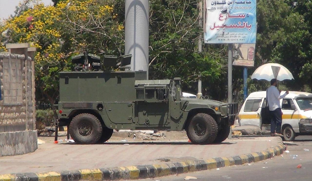 A military vehicle is positioned on a street in Yemen's southern city of Aden March 22, 2015. Houthi fighters opposed to Yemen's president took over the central city of Taiz in an escalation of a power struggle diplomats say risks drawing in neighboring oil giant Saudi Arabia and its main regional rival Iran. Residents of Taiz, on a main road from the capital Sanaa to the country's second city of Aden, said that Houthi militias took over the city's military airport without a struggle from local authorities late on Saturday. REUTERS/Yaser Hasan