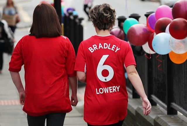 <p>Mourners arrive ahead of the funeral of Bradley Lowery, the six-year-old football mascot whose cancer battle captured hearts around the world </p>
