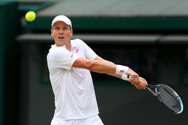 LONDON, ENGLAND - JULY 03: Tomas Berdych of Czech Republic plays a backhand during the Gentlemen's Singles quarter-final match against Novak Djokovic of Serbia on day nine of the Wimbledon Lawn Tennis Championships at the All England Lawn Tennis and Croquet Club at Wimbledon on July 3, 2013 in London, England. (Photo by Julian Finney/Getty Images)
