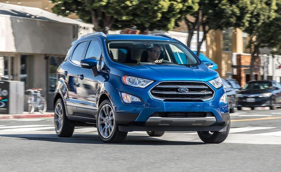 """<p>The <a href=""""https://www.caranddriver.com/ford/ecosport"""" rel=""""nofollow noopener"""" target=""""_blank"""" data-ylk=""""slk:Ford EcoSport"""" class=""""link rapid-noclick-resp"""">Ford EcoSport</a> is a wee lad. It's a foot shorter in length than the recently discontinued <a href=""""https://www.caranddriver.com/ford/fiesta"""" rel=""""nofollow noopener"""" target=""""_blank"""" data-ylk=""""slk:Fiesta"""" class=""""link rapid-noclick-resp"""">Fiesta</a>. We fit 18 carry-on suitcases behind the front seats, and its the only tiny traveler in the segment with left-hinged rear door that opens to the side rather than upward. Interesting note: the EcoSports's glovebox has a vent inside that blows air from the climate control. </p><ul><li>Base price: $21,240</li><li>Carry-on capacity, rear seats folded: 18 suitcases</li><li>Cargo volume, rear seats folded: 50 cubic feet<br></li><li>Cargo volume, behind rearmost row of seats: 20 cubic feet</li></ul><p><a class=""""link rapid-noclick-resp"""" href=""""https://www.caranddriver.com/ford/ecosport/specs"""" rel=""""nofollow noopener"""" target=""""_blank"""" data-ylk=""""slk:MORE ECOSPORT SPECS"""">MORE ECOSPORT SPECS</a></p>"""