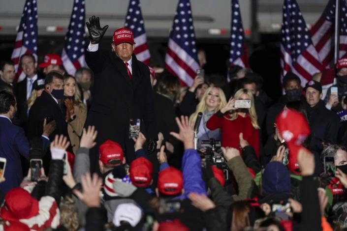 President Donald Trump waves to the crowd after speaking at a campaign event at the Kenosha Regional Airport Monday, Nov. 2, 2020, in Kenosha, Wis. (AP Photo/Morry Gash)