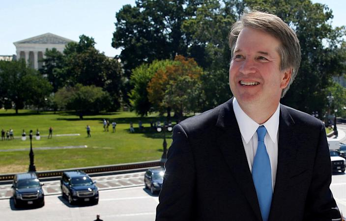 """<span class=""""s1"""">With the Supreme Court building in the background, Brett Kavanaugh arrives on Capitol Hill for a meeting with Senate Majority Leader Mitch McConnell on July 10. (Photo: Joshua Roberts/Reuters)</span>"""