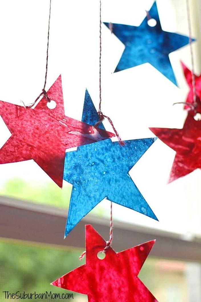 """<p>Put old, broken crayons to use with this easy sun catcher craft.</p><p><em><strong>Get the tutorial from <a href=""""http://www.thesuburbanmom.com/2014/06/27/4th-of-july-star-sun-catchers-kids-craft/#5ZkSZQV6hovF9f3S.32"""" rel=""""nofollow noopener"""" target=""""_blank"""" data-ylk=""""slk:The Suburban Mom"""" class=""""link rapid-noclick-resp"""">The Suburban Mom</a>. </strong></em> </p>"""