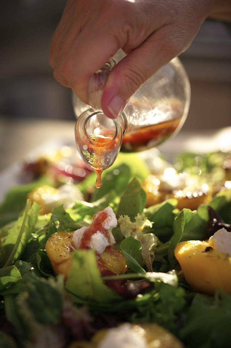 """<p><strong>Recipe:</strong> <a href=""""https://www.southernliving.com/recipes/regina-charboneau-grilled-peach-salad"""" rel=""""nofollow noopener"""" target=""""_blank"""" data-ylk=""""slk:Grilled Peach Salad with Chipotle-Raspberry Vinaigrette"""" class=""""link rapid-noclick-resp"""">Grilled Peach Salad with Chipotle-Raspberry Vinaigrette</a></p> <p>This grilled summer salad will tone down the char flavor from your hot dog. Sweet peaches meet a little bit of kick from the chipotle vinaigrette. </p>"""