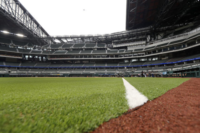 The roof sits open as seen from right field at Globe Life Field, the newly-built home of the Texas Rangers, in Arlington, Texas, Wednesday, May 20, 2020. The park that was supposed to have its home opener on March 31 against the Los Angeles Angels has yet to see one game played in it this season amid the coronavirus pandemic. (AP Photo/Tony Gutierrez)