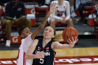 FILE - St. John's guard Kadaja Bailey (30) fouls Connecticut guard Paige Bueckers (5) during the second quarter of an NCAA college basketball game in New York, in this Wednesday, Feb. 17, 2021, file photo. Paige Bueckers is in a class all by herself. UConn's star guard became the first freshman ever to win The Associated Press women's basketball player of the year award on Wednesday, March 31, 2021. (AP Photo/Kathy Willens, File)