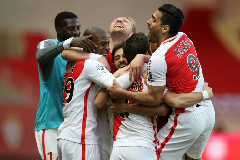 Monaco players celebrate after Moutinho scores their second goal against Bordeaux on March 11, 2017 at the Louis II Stadium in Monaco