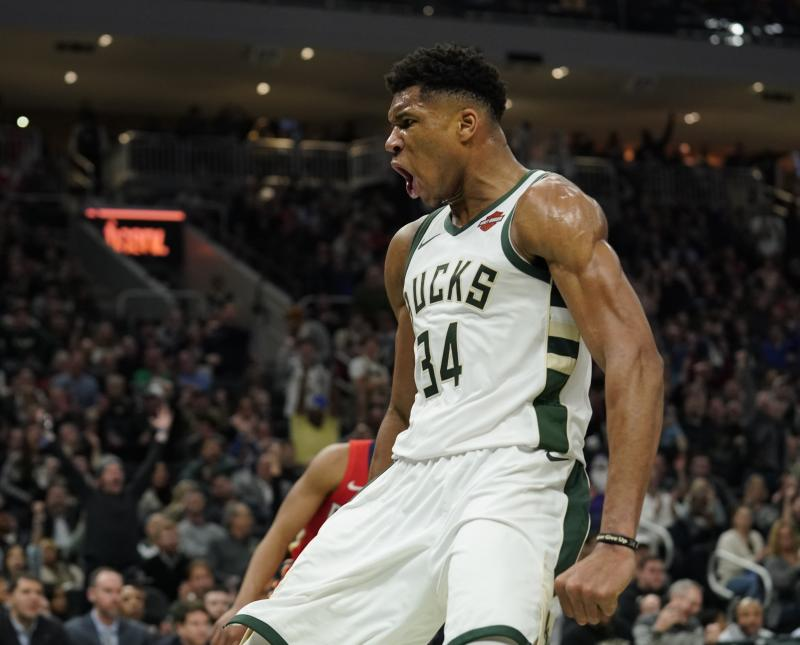 Milwaukee Bucks' Giannis Antetokounmpo reacts after a dunk during the second half of an NBA basketball game against the New Orleans Pelicans Wednesday, Dec. 19, 2018, in Milwaukee. The Bucks won 123-115. (AP Photo/Morry Gash)