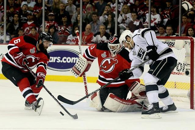 NEWARK, NJ - JUNE 09: Andy Greene #6 of the New Jersey Devils goes for a loose puck against Dustin Brown #23 of the Los Angeles Kings in front of Martin Brodeur #30 during Game Five of the 2012 NHL Stanley Cup Final at the Prudential Center on June 9, 2012 in Newark, New Jersey. (Photo by Elsa/Getty Images)
