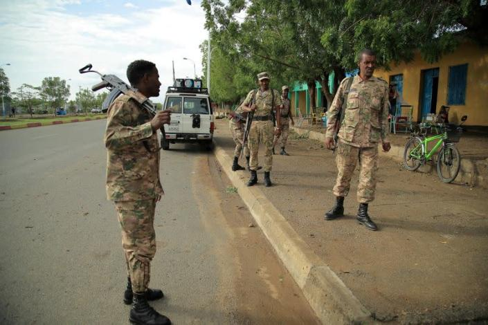 FILE PHOTO: Members of Amhara Special Forces stand guard along a street in Humera town